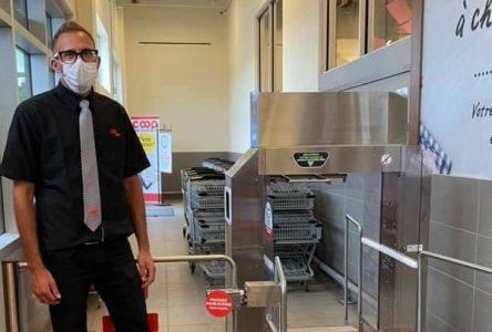 Un nouveau système de désinfection des paniers et des mains au IGA